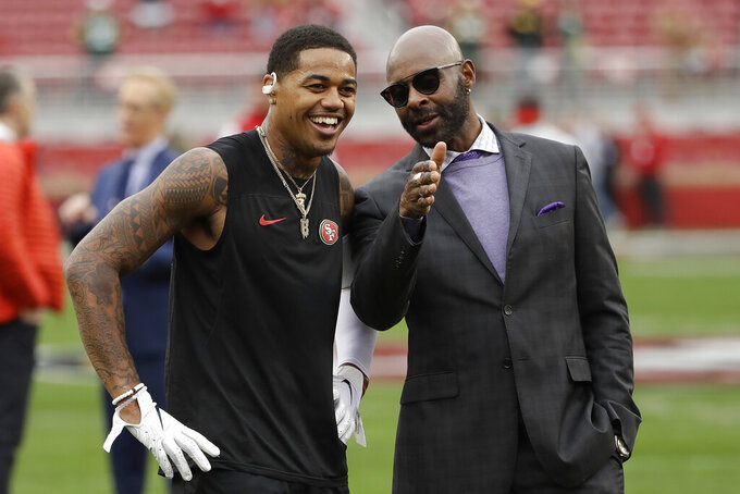 San Francisco 49ers wide receiver Kendrick Bourne, left, talks with former 49ers wide receiver Jerry Rice as players warm up before the NFL NFC Championship football game between the 49ers and the Green Bay Packers Sunday, Jan. 19, 2020, in Santa Clara, Calif. (AP Photo/Marcio Jose Sanchez)
