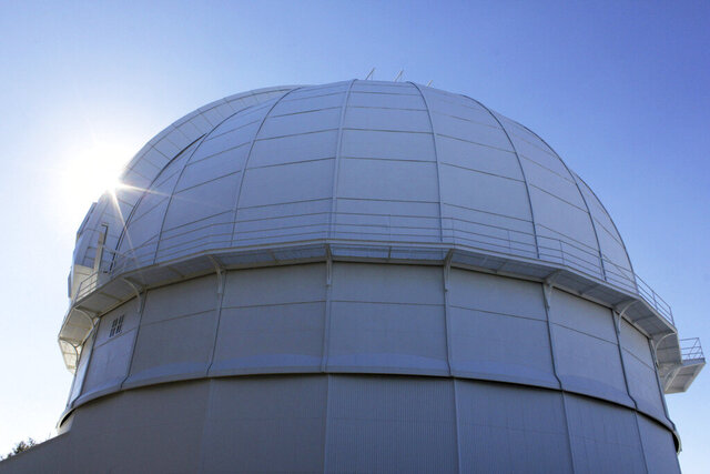FILE - This Aug. 9, 2014, file photo, shows the dome of the historic Mount Wilson Observatory, which houses the 100-inch (254 cm) Hooker Telescope in the San Gabriel Mountains northeast of Los Angeles. Firefighters burned off vegetation on Tuesday, Sept. 15, 2020, to protect the observatory from a wildfire. (AP Photo/John Antczak, File)