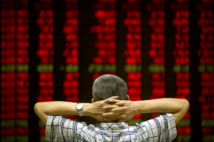A Chinese investor monitors stock prices at a brokerage house in Beijing, China, Thursday, Aug. 9, 2018. (AP Photo/Mark Schiefelbein)