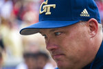 """FILE - Georgia Tech coach Geoff Collins is shown before an NCAA college football game against Georgia in Atlanta, in this Saturday, Nov. 30, 2019, file photo. With season three upcoming for the coach Geoff Collins era at Georgia Tech, words and phrases like """"re-building"""" and """"re-shaping"""" may no longer be pliable. The Yellow Jackets have been dreadful in the first two seasons after option offense afficiando Paul Johnson retired. (AP Photo/John Amis, File)"""