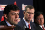 Boston Red Sox's Chaim Bloom, left, speaks at a news conference as team president and CEO Sam Kennedy, middle, and team chairman Tom Werner listen, Monday, Oct. 28, 2019, at Fenway Park in Boston. It was announced that Bloom will be the baseball team's Chief Baseball Officer and will be responsible for all matters of baseball operations. (AP Photo/Elise Amendola)