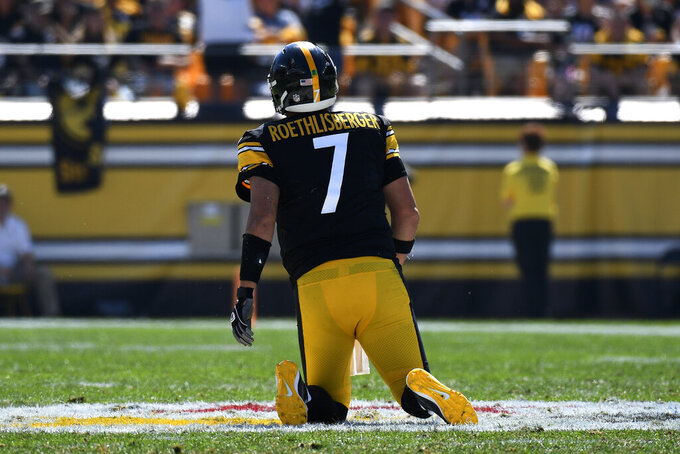 Pittsburgh Steelers quarterback Ben Roethlisberger (7) gets up slowly after being sacked during the first half of an NFL football game against the Las Vegas Raiders in Pittsburgh, Sunday, Sept. 19, 2021. (AP Photo/Don Wright)