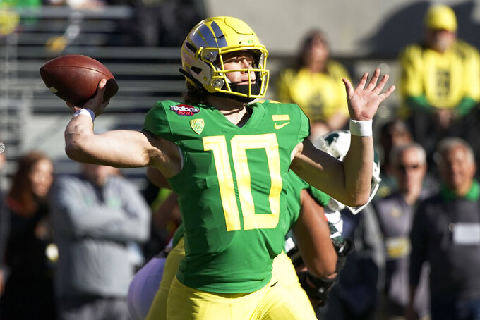 FILE - In this Dec. 31, 2018, file photo, Oregon quarterback Justin Herbert throws a pass during the first half of the Redbox Bowl NCAA college football game in Santa Clara, Calif. Herbert is among the top returning talents in the Pac-12, and the Ducks' hopes of league title contention in coach Mario Cristobal's second season could hinge on whether his quarterback improves on last year's 3,000-yard campaign. (AP Photo/Tony Avelar, File)