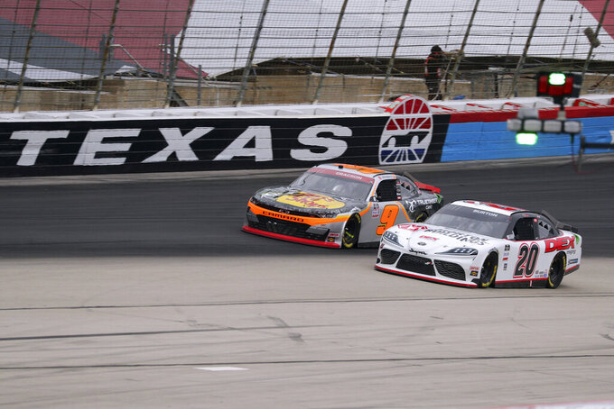 Noah Gregson (9) and Harrison Burton (20) come out of turn four down the front stretch during a NASCAR Xfinity Series auto race at Texas Motor Speedway in Fort Worth, Texas, Saturday, Oct. 24, 2020. (AP Photo/Richard W. Rodriguez)