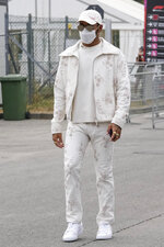 Mercedes driver Lewis Hamilton of Britain arrives to attend the first practice session for Sunday's Italian Formula One Grand Prix, at the Monza racetrack, in Monza, Italy, Friday, Sept. 10, 2021. (AP Photo/Luca Bruno)