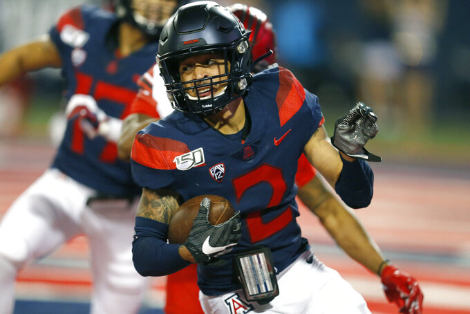 Arizona cornerback Lorenzo Burns runs with an interception against Utah during the second half of an NCAA college football game Saturday, Nov. 23, 2019, in Tucson, Ariz. (AP Photo/Rick Scuteri)