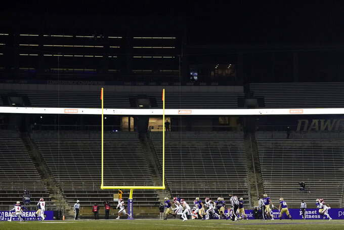 Washington plays against Utah in an otherwise empty Husky Stadium during the second half of an NCAA college football game Saturday, Nov. 28, 2020, in Seattle. Washington won 24-21, and due to the COVID-19 pandemic, no fans were in attendance. (AP Photo/Ted S. Warren)
