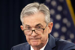 """FILE - In this July 31, 2019, file photo, Federal Reserve Chairman Jerome Powell speaks during a news conference following a two-day Federal Open Market Committee meeting in Washington. President Donald Trump is calling on the Federal Reserve to cut interest rates by at least a full percentage-point """"over a fairly short period of time,"""" saying such a move would make the U.S. economy even better and would also """"greatly and quickly"""" enhance the global economy. In two tweets Monday, Aug. 19, Trump kept up his pressure on the Fed and Powell, saying the U.S. economy was strong """"despite the horrendous lack of vision by Jay Powell and the Fed."""" (AP Photo/Manuel Balce Ceneta, File)"""