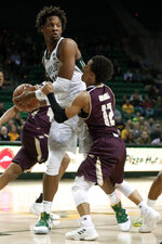 Baylor forward Freddie Gillespie (33) grabs a defensive rebound in front of Texas State guard Mason Harrell (12) during the first half of an NCAA college basketball game in Waco, Texas, Friday, Nov. 15, 2019. (AP Photo/Tony Gutierrez)