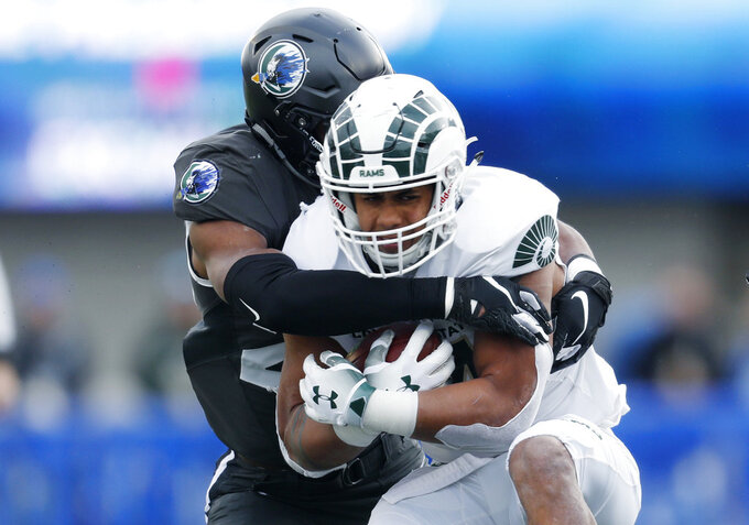 Air Force linebacker Kyle Floyd, left, wraps up Colorado State running back Izzy Matthews after a short gain in the first half of an NCAA college football game Thursday, Nov. 22, 2018, at Air Force Academy, Colo. (AP Photo/David Zalubowski)