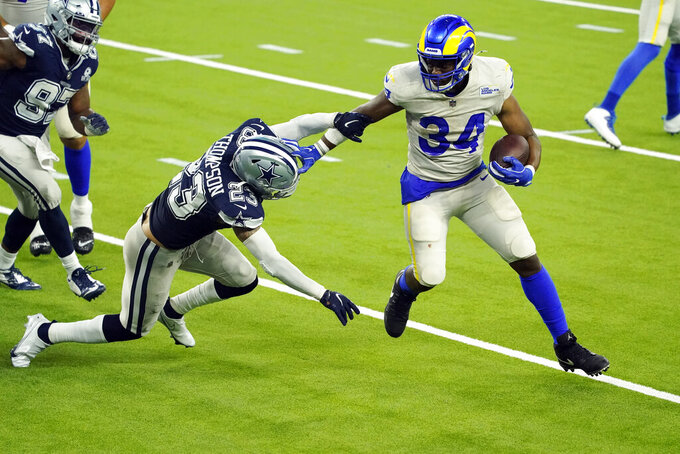 Los Angeles Rams running back Malcolm Brown (34) runs around Dallas Cowboys safety Darian Thompson (23) to score a touchdown during the second half of an NFL football game Sunday, Sept. 13, 2020, in Inglewood, Calif. (AP Photo/Ashley Landis)