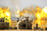 An Israeli artillery unit fires toward targets in Gaza Strip, at the Israeli Gaza border, Wednesday, May 12, 2021. (AP Photo/Yonatan Sindel)