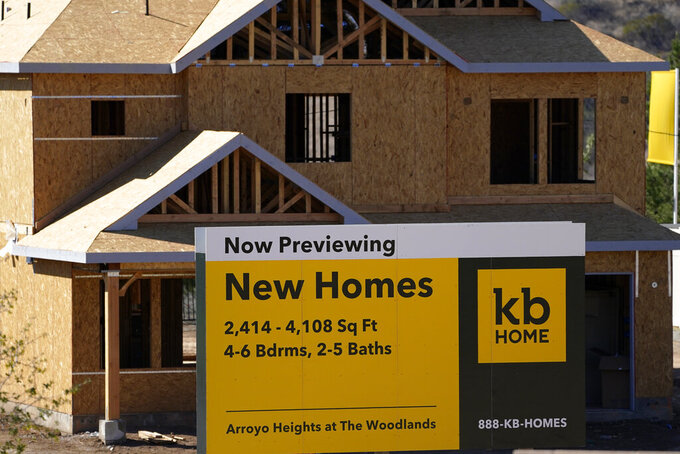 A sign sits in front of a KB Home construction site, Tuesday, Feb. 2, 2021, in Simi Valley, Calif.  U.S. homebuilders are poised to benefit this spring homebuying season amid strong demand, low mortgage rates and an all-time low inventory of previously occupied homes for sale. But soaring lumber prices and a shortage of construction-ready land could limit builders' ability to capitalize on the strong housing market trends, analysts say.  .(AP Photo/Mark J. Terrill)