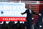 Democratic presidential candidate entrepreneur Andrew Yang walks on stage to speak at the Iowa Democratic Party's Liberty and Justice Celebration, Friday, Nov. 1, 2019, in Des Moines, Iowa. (AP Photo/Charlie Neibergall)