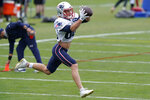 New England Patriots wide receiver Gunner Olszewski (80) catches a pass during an NFL football training camp practice, Thursday Aug. 27, 2020 in Foxborough, Mass. (AP Photo/Steven Senne, Pool)