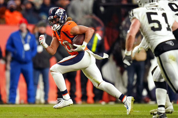 Denver Broncos running back Phillip Lindsay runs with the ball during the second half of an NFL football game against the Oakland Raiders, Sunday, Dec. 29, 2019, in Denver. Lindsay broke 1000 yards for the season on the play. (AP Photo/Jack Dempsey)