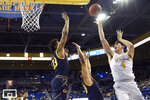 UCLA guard Jaime Jaquez Jr., right, shoots as California forward D.J. Thorpe, left, and guard Matt Bradley defend during the first half of an NCAA college basketball game Sunday, Jan. 19, 2020, in Los Angeles. (AP Photo/Mark J. Terrill)