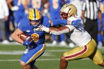 Pittsburgh quarterback Kenny Pickett (8) evades Boston College linebacker Max Richardson during the first half of an NCAA college football game, Saturday, Oct. 10, 2020, in Boston. (AP Photo/Michael Dwyer)