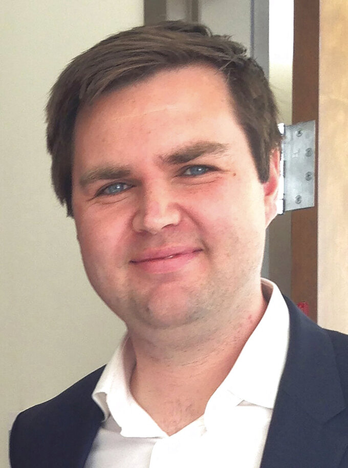 """FILE - In this Nov. 16, 2016, file photo, author J.D. Vance poses after a luncheon with teachers ahead of his talk and book signing at the school's student center in Oxford, Ohio. Vance, the venture capitalist and author of """"Hillbilly Elegy"""" appears poised to join the crowded Republican race for the Ohio U.S. Senate seat being left by Rob Portman. (AP Photo/Dan Sewell)"""