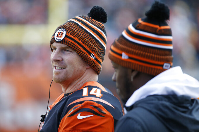 Cincinnati Bengals quarterback Andy Dalton (14) stands on the sidelines during the first half an NFL football game against the Pittsburgh Steelers, Sunday, Nov. 24, 2019, in Cincinnati. (AP Photo/Frank Victores)