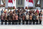 Indonesian President Joko Widodo, front row sixth from left, and his deputy Ma'ruf Amin, seventh from left, pose for photographers during the announcement of the new cabinet at Merdeka Palace in Jakarta, Indonesia, Wednesday, Oct. 23, 2019. (AP Photo/Dita Alangkara)