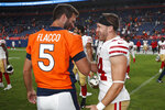 Denver Broncos quarterback Joe Flacco (5) greets San Francisco 49ers fullback Kyle Juszczyk (44) after an NFL preseason football game, Monday, Aug. 19, 2019, in Denver. The 49ers won 24-15. (AP Photo/David Zalubowski)