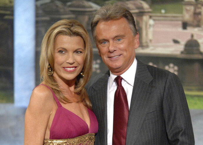 FILE - In this Sept. 29, 2007 file photo, co-host Vanna White and host Pat Sajak make an appearance at Radio City Music Hall for a taping of celebrity week on