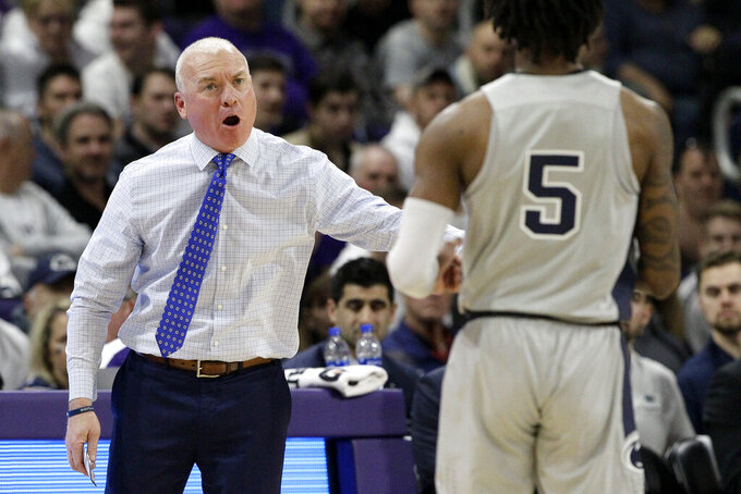 Penn State head coach Patrick Chambers, left, talks to guard Jamari Wheeler during the first half of an NCAA college basketball game against Northwestern in Evanston, Ill., Saturday, March 7, 2020. (AP Photo/Nam Y. Huh)