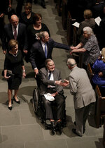 Former Presidents George H.W. Bush and George W. Bush greet mourners after a funeral service for former first lady Barbara Bush at St. Martin's Episcopal Church, Saturday, April 21, 2018, in Houston. (AP Photo/David J. Phillip , Pool)