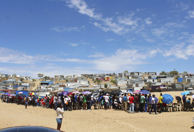 Namibians queue to cast their votes at a polling station near Windhoek, Namibia in the country's elections Wednesday, Nov. 27, 2019. Namibian President Hage Geingob's ruling party faces its biggest challenge since independence nearly three decades ago. The resource-rich southern African nation's registered 1.3 million voters are voting for president and National Assembly members. (AP Photo/Brandon van Wyk)