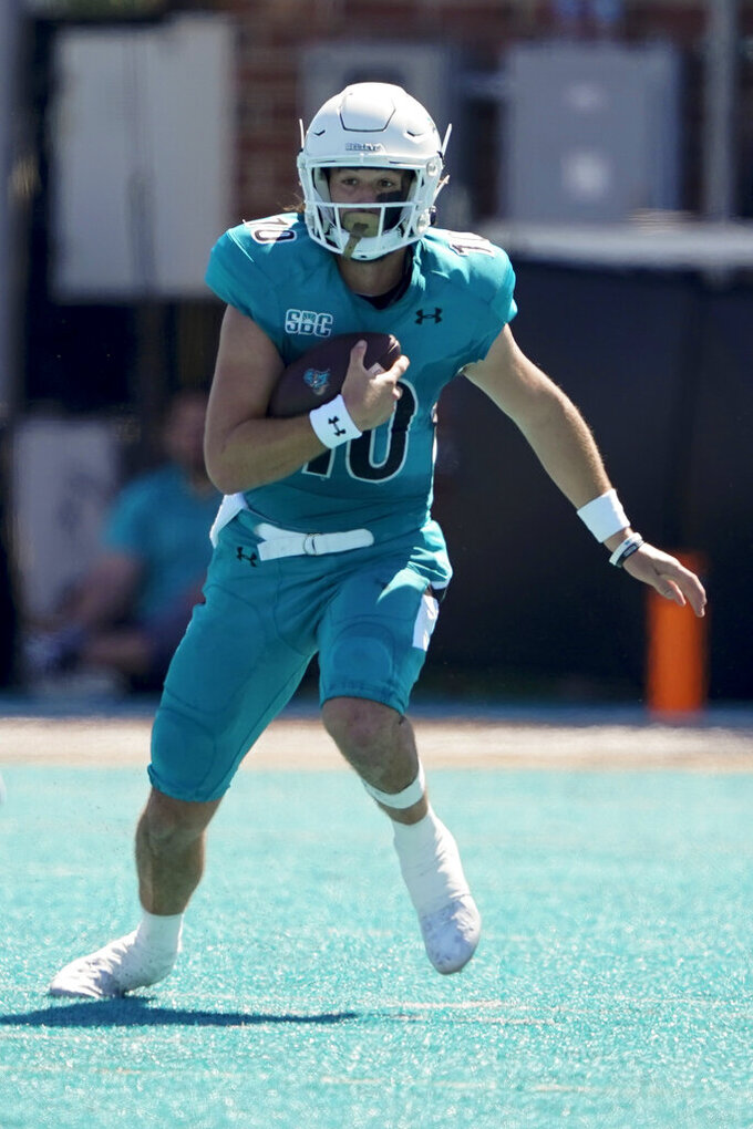 Coastal Carolina quarterback Grayson McCall runs against Massachusetts during the first half of an NCAA college football game on Saturday, Sept. 25, 2021, in Conway, S.C. (AP Photo/Chris Carlson)