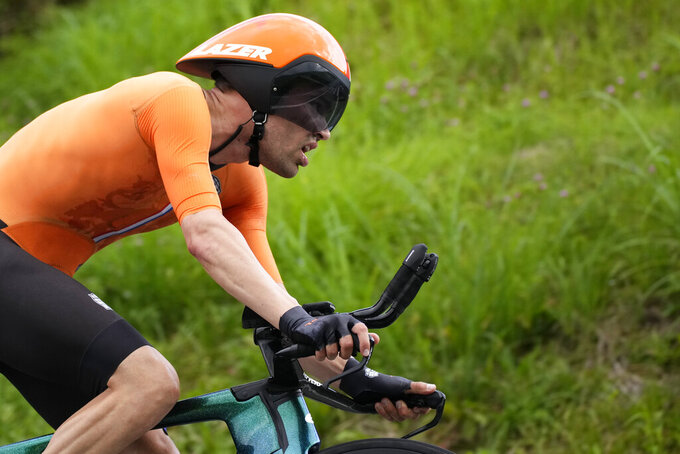 Tom Dumoulin of The Netherlands competes during the men's cycling individual time trial at the 2020 Summer Olympics, Wednesday, July 28, 2021, in Oyama, Japan. (AP Photo/Christophe Ena)