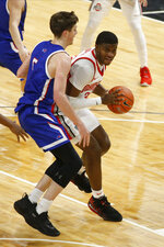 Ohio State's E.J. Liddell, right, posts up against UMass-Lowell's Connor Withers during the first half of an NCAA college basketball game Sunday, Nov. 29, 2020, in Columbus, Ohio. (AP Photo/Jay LaPrete)