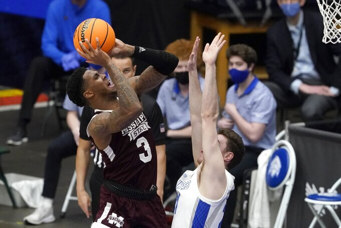 Mississippi State guard D.J. Stewart Jr. (3) attempts a shot over Saint Louis guard Gibson Jimerson, right, during the first half of an NCAA college basketball game in the first round of the NIT Tournament, Saturday, March 20, 2021, in Frisco, Texas. (AP Photo/Tony Gutierrez)
