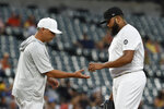 Tampa Bay Rays starting pitcher Jose Alvarado, right, hands the baseball to manager Kevin Cash as he leaves during the first inning of the team's baseball game against the Baltimore Orioles on Saturday, Aug. 24, 2019, in Baltimore. (AP Photo/Gail Burton)