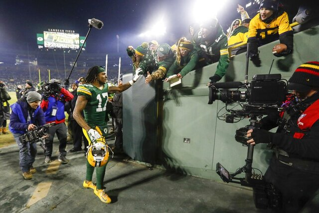 Green Bay Packers' Davante Adams celebrates with fans after an NFL divisional playoff football game against the Seattle Seahawks Sunday, Jan. 12, 2020, in Green Bay, Wis. The Packers won 28-23 to advance to the NFC Championship. (AP Photo/Mike Roemer)