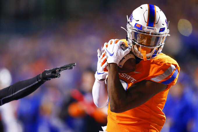 Boise State wide receiver John Hightower pulls in the ball on a 26-yard touchdown reception against Hawaii during the first half of an NCAA college football game Saturday, Oct. 12, 2019, in Boise, Idaho. (AP Photo/Steve Conner)