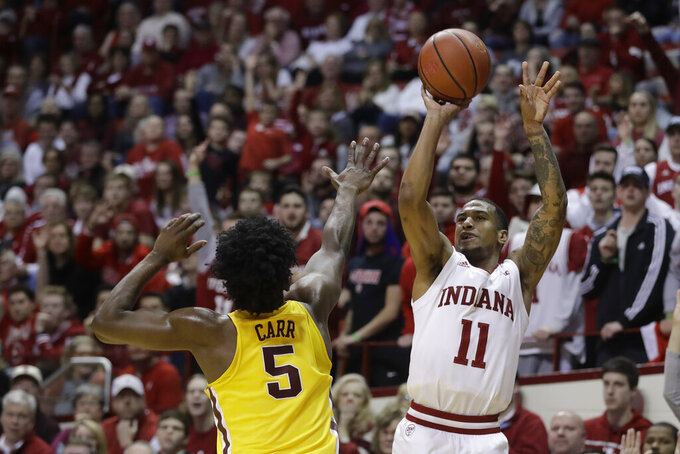 Indiana's Devonte Green (11) shoots against Minnesota's Marcus Carr (5) during the first half of an NCAA college basketball game, Wednesday, March 4, 2020, in Bloomington, Ind. (AP Photo/Darron Cummings)