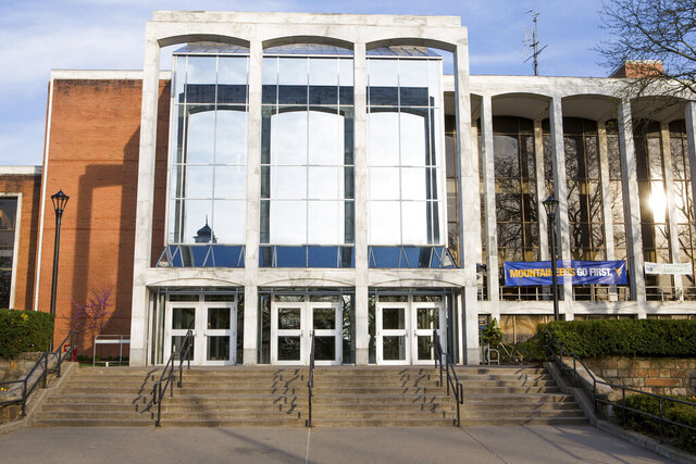 FILE - This April, 24, 2015 file photo shows Mountainlair Student Union on West Virginia University downtown campus in Morgantown, W.Va. West Virginia University students will face penalties and discipline if they fail to get tested for the coronavirus and complete a COVID-19 education course before returning to campus next month, the university said Tuesday, July 21, 2020.  (AP Photo/Raymond Thompson, File)