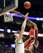 Georgia guard Jordan Harris (2) misses a dunk against Missouri forward Reed Nikko (14) in the first half of an NCAA college basketball game at the Southeastern Conference tournament, Wednesday, March 13, 2019, in Nashville, Tenn. (AP Photo/Mark Humphrey)