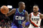 Charlotte Hornets guard Terry Rozier, left, dribbles the ball on Portland Trail Blazers guard Damian Lillard, right, during the first half of an NBA basketball game in Portland, Ore., Monday, Jan. 13, 2020. (AP Photo/Steve Dykes)