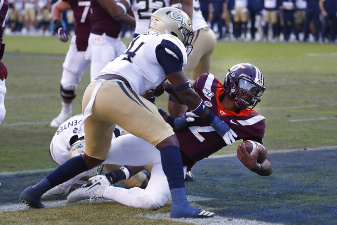 Virginia Tech quarterback Hendon Hooker (2) scores a touchdown on a short run as Georgia Tech linebacker Quez Jackson (44) defends in the first half of an NCAA football game Saturday, Nov. 16, 2019, in Atlanta. (AP Photo/John Bazemore)