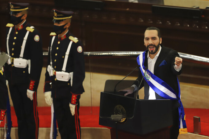 FILE - In this June 1, 2021 file photo, El Salvadoran President Nayib Bukele delivers his annual address to the nation before Congress, in San Salvador, El Salvador. On Wednesday, Sept. 15, 2021, thousands of people marched against Bukele's government, centering on fears he may try for re-election, concern about the his concentration of power and the controversial decision to make the cryptocurrency Bitcoin legal tender. (AP Photo/Salvador Melendez, File)