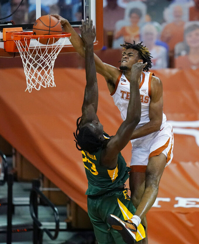 Texas forward Greg Brown, right, scores over Baylor forward Jonathan Tchamwa Tchatchoua (23) during the second half of an NCAA college basketball game Tuesday, Feb. 2, 2021, in Austin, Texas. (AP Photo/Eric Gay)