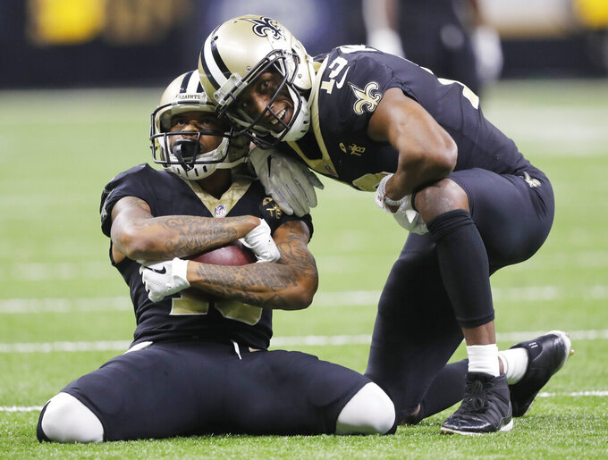 New Orleans Saints' Ted Ginn celebrates with Michael Thomas after a long catch during the second half the NFL football NFC championship game against the Los Angeles Rams Sunday, Jan. 20, 2019, in New Orleans. (AP Photo/Gerald Herbert)