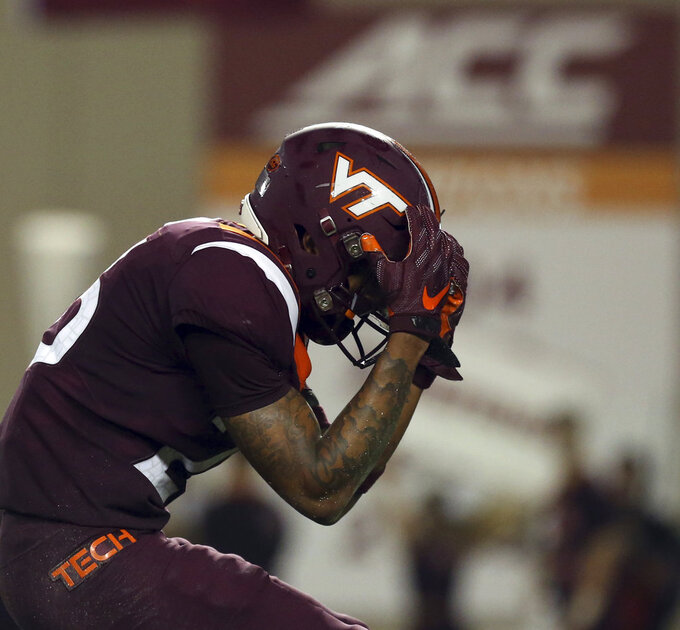 Virginia Tech defensive back Jovonn Quillen reacts after missing an interception opportunity during the first half of an NCAA college football game against Notre Dame on Saturday, Oct. 6, 2018, in Blacksburg, Va. (Matt Gentry/The Roanoke Times via AP)