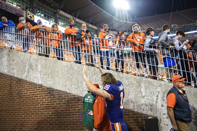 Clemson quarterback Trevor Lawrence (16) waves to fans as he leaves the team's home field for the last time, after the team's win over Pittsburgh in an NCAA college football game Saturday, Nov 28, 2020, in Clemson, S.C. (Ken Ruinard/The Independent-Mail via AP, Pool)