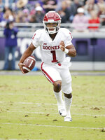 Oklahoma quarterback Kyler Murray (1) keeps the ball during the first half of an NCAA college football game against TCU, Saturday, Oct. 20, 2018, in Fort Worth, Texas. Oklahoma won 52-27. (AP Photo/Brandon Wade)