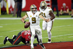New Orleans Saints quarterback Drew Brees (9) scrambles away from Tampa Bay Buccaneers defensive end William Gholston (92) during the first half of an NFL football game Sunday, Nov. 8, 2020, in Tampa, Fla. (AP Photo/Jason Behnken)