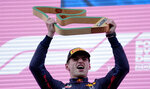 Red Bull driver Max Verstappen of the Netherlands raises the trophy after winning the Styrian Formula One Grand Prix at the Red Bull Ring racetrack in Spielberg, Austria, Sunday, June 27, 2021. (AP Photo/Darko Vojinovic)